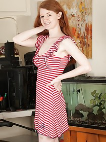 Redheaded cutie in a striped dress showing off her smooth ole