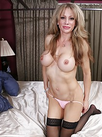 Bodysuit-wearing MILF blonde teasing her pussy with a weird toy
