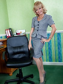 Office worker GILF takes off her lingerie and masturbates next to her desk